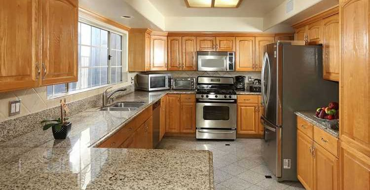 Before & After: This Builder-Basic Kitchen Goes Glam with a Marble Makeover